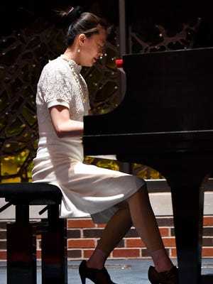 """Wenhui """"Sherry"""" Dou performs on the piano during a Black History month event Feb. 20 at Hardin-Simmons University. Dou is the pianist for Ericksdahl's Bethel Lutheran Church in Jones County."""