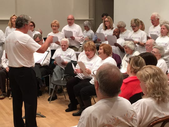 The Side by Side choir, filled with patients with dementia and their caregivers, performs in the Wilson Auditorium at the Montgomery Museum of Fine Arts on Tuesday.