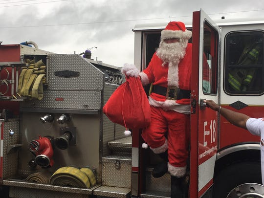 """Santa Claus (Sgt. Buck Wilkins of the Bossier Parish Sheriff's Office) greeted children from Bossier Head Start on Monday as local law enforcement's holiday initiative, """"Operation Santa Claus,"""" kicked off. The community is asked to help by donating monetarily or with unwrapped Christmas gifts."""