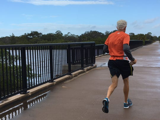 Runner crosses Venice, Florida's, Roberts Bay via the Legacy Trail. Friends of the Legacy Trail aspire to extending the nearly 11-mile bike-ped feature another 7.5 miles, to downtown Sarasota.