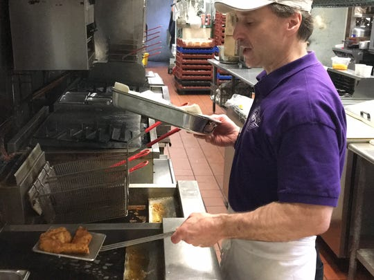 Scott Sleeter, assistant kitchen manager at Hilltop Pub & Grill, fries up a fish fry.