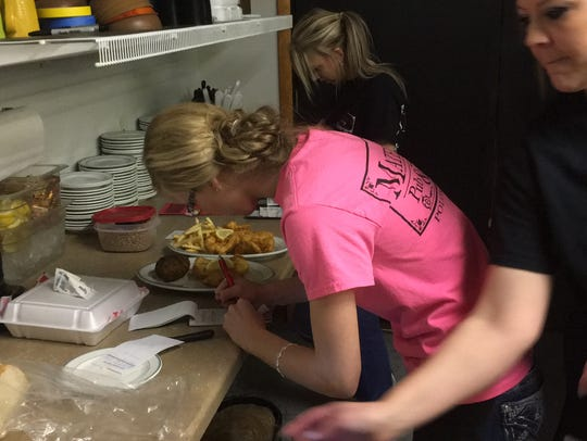Staff gets orders of fish fry ready at Matero's Pub