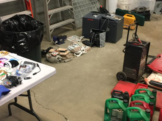 Items stolen in a series of burglaries iand car breakins fill the floor in the police evidence room.