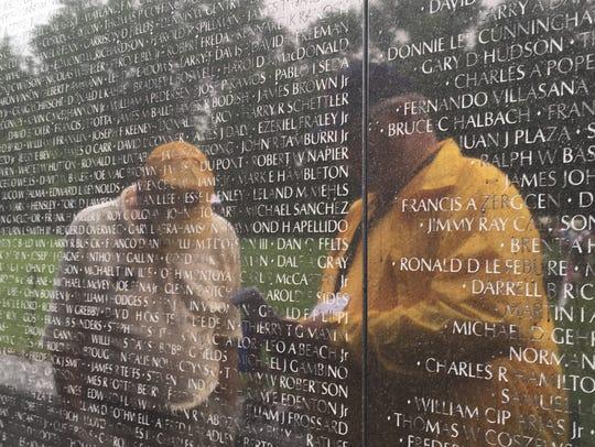 A volunteer (left) and a Never Forgotten Honor Flight