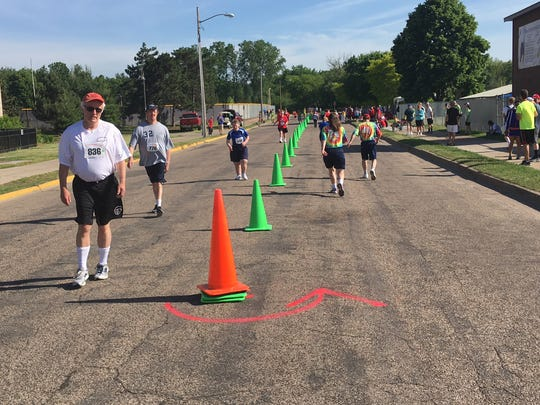 Athletes take part in the 1,500-meter walk at the University of Wisconsin-Stevens Point during the Special Olympics Wisconsin State Summer Games on Saturday, June 10, 2017.