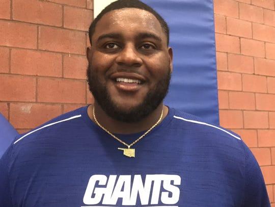 Giants defensive tackle Robert Thomas speaks to reporters