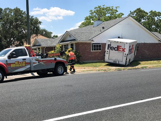 A FedEx delivery truck struck at house in the 7200