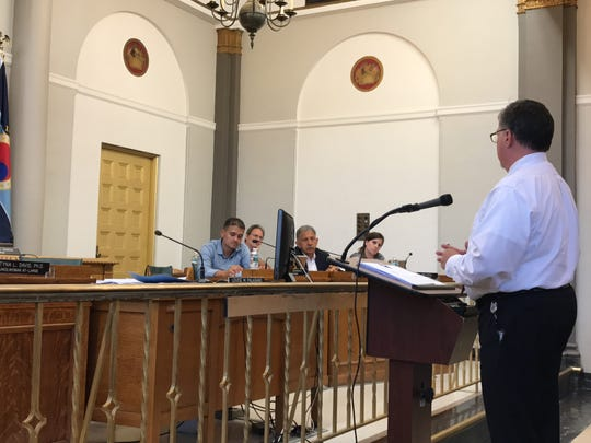 Bloomfield Township Administrator Matthew Watkins speaks to the council on Monday, Aug. 21, 2017.