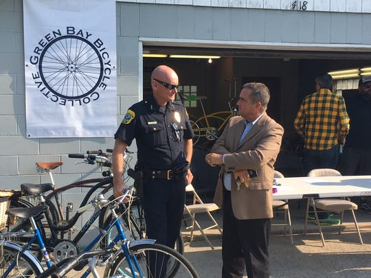 Green Bay Police Chief Andrew Smith and Mayor Jim Schmitt joined members of the Green Bay Bicycle Collective to launch a free community bike shop in a city-owned garage at 418 N. 4th St. on Sept. 15.