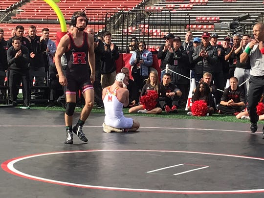 Rutgers sophomore Nick Suriano approaches the center circle after his tech fall win over Brandon Cray of Maryland.