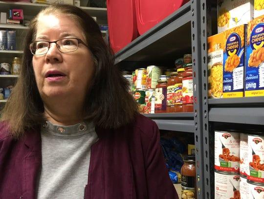 Linda Howe, director of the Winooski Food Shelf, speaks