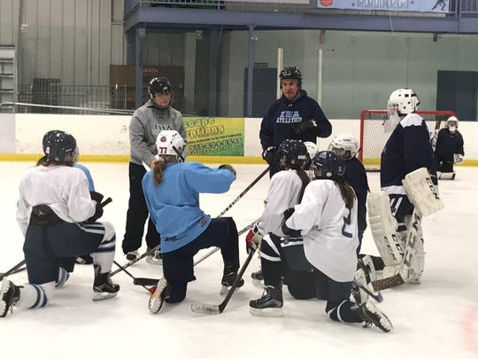 Assistant coaches Michaela Muckell (facing, in gray) and Bob Chichetti (in blue) with the Immaculate Heart girls hockey team at practice at Ice Vault on Thursday, Dec. 7, 2017.