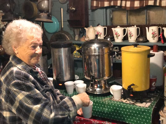 Pat Kelly fixes a cup of hot chocolate for a visitor to Tiny Town.