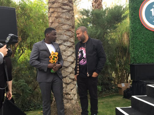 """""""Get Out"""" star Daniel Kaluuya holds his Creative Impact in Acting Award from Variety, presented to him by director Jordan Peele at the Parker Palm Springs.  (Jan. 3, 2018)"""