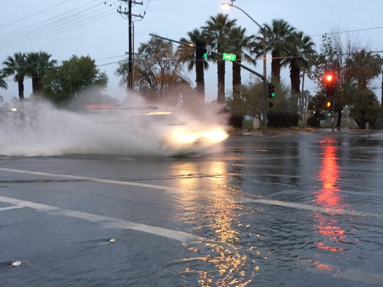 This photo shows a vehicle passing through the flooded intersection of Farrell Drive and Ramon Road in Palm Springs. The city received more than 1.4 inches of rain on January 9, which was the area's wettest day this year.