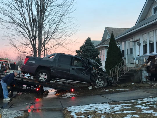A Chevy Avalanche with Kansas tags crashed into an abandoned house on Essex Street in Gloucester City Jan. 11, 2018.