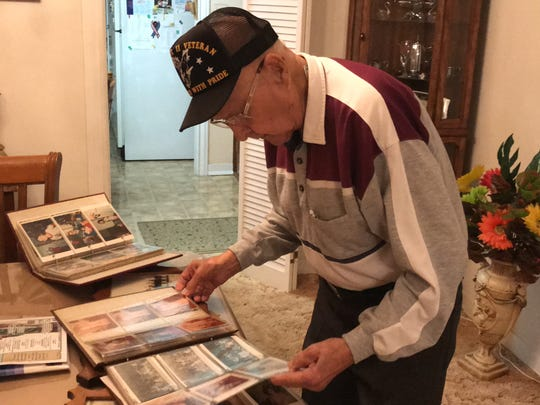Jesse Cisneros, 92, reminisces through decades of photos that feature his wife Angela C. Cisneros, 89. The couple have been together almost 70 years.