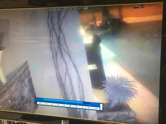 Security camera footage shows a person in robe and mask outside Wang's in the Desert on the morning of Jan. 20, 2018.