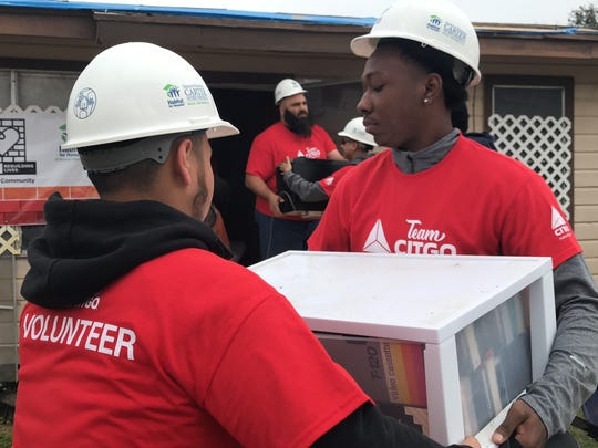 Citgo volunteers assist Tina Solis, a Rockport resident who received damage to her home from Hurricane Harvey. Her home is one of 22 that will be rebuilt in the Rockport community.
