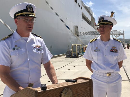 Capt. David Bretz, Commander of Destroyer Squadron 13, left, with Capt. Peter Robert, USNS Mercy Commanding Officer, announces the start of the 13th year of the Pacific Partnership. The Pacific Partnership 2018, is the largest annual multilateral humanitarian assistance and disaster relief preparedness mission conducted in the Indo-Pacific Region.