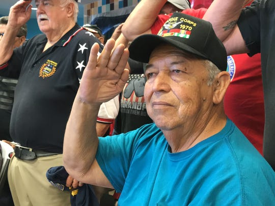Richard Fuentes, 70, salutes during the 7th annual