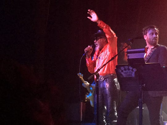 Louisiana musician Robert Finley (left) performs with