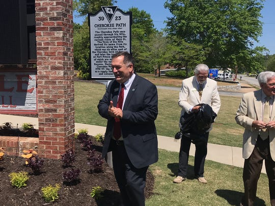 Six Mile Town Councilman James Atkinson and Ken Nabors of the Pickens County Historical Society and Mayor Roy Stoddard after unveiling of a historical marker in front of Town Hall.
