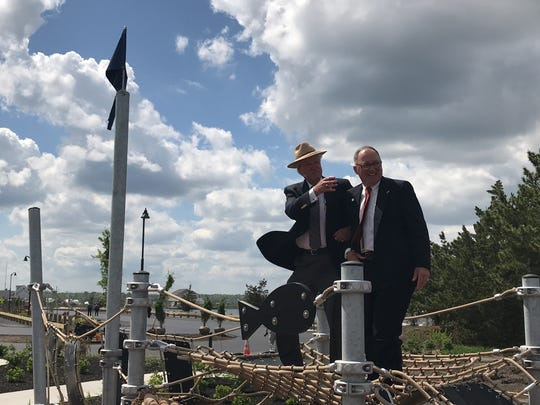 Ocean County Freeholders John C. Bartlett Jr. (left) and Gerry P. Little (right) stand atop one of the playground pieces at the newly rebuilt Berkeley Island County Park in Berkeley Township on Wednesday, May 23, 2018.
