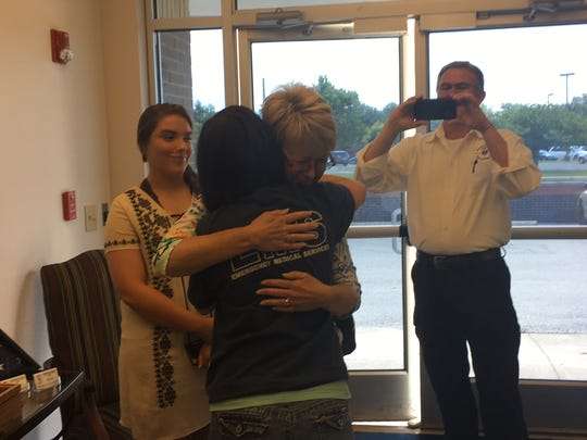 Connie Dudley hugs Marsha Duncan when they meet for