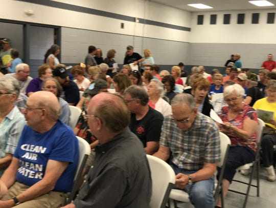 More than 200 people fill the Saratoga Town Hall June