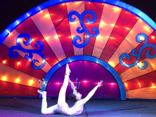 A contortionist performs during the Dragon Lights Festival