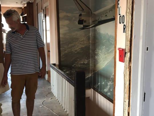 Pat Fasano, owner of the former Hotel Powhatan, walks