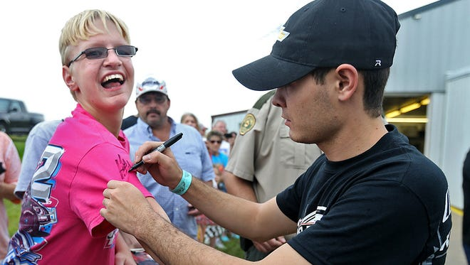 Shawn Barker, left, 17 of Carlisle, was ecstatic to have his shirt autographed by NASCAR star driver Kyle Larson, right.
