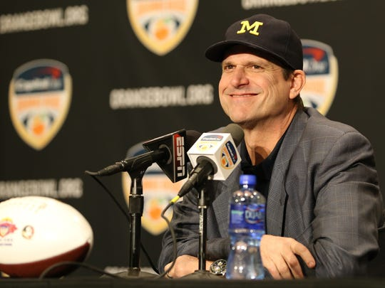 Michigan head coach Jim Harbaugh speaks to the media at the Renaissance Hotel in Ft. Lauderdale, Fla. on Thursday, December 29, 2016.