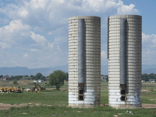 Silos stand tall above the Strang gravel pit along Strauss Cabin Road. A cabin, built in 1890 by James Strang, has been leveled in the same area.
