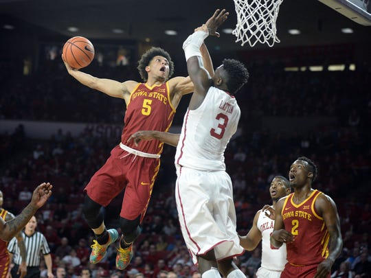 Iowa State guard Lindell Wigginton dunks the ball over Oklahoma's Khadeem Lattin during their game at Lloyd Noble Center on March 2, 2018, in Norman, Oklahoma.