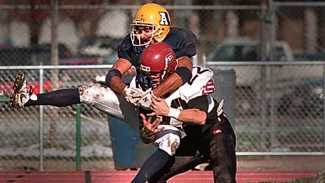 Matt McPhie goes up for a pass in a game against St. Cloud State at Howard Wood Field during his playing days at Augustana. McPhie recently served as the Vikings' wide receivers coach.