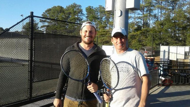 Blake Foster, left, and Scott Baehr won the doubles title of the 2016 Pensacola Clay Court City Championships. Baehr also claimed his 12th singles crown.