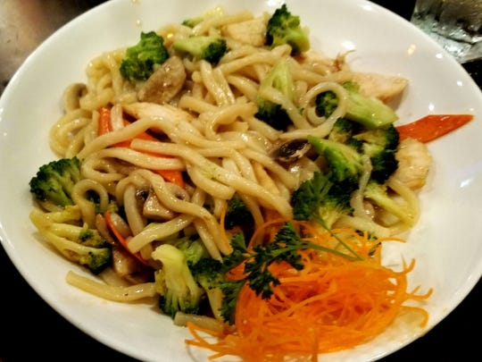 Hokkaido's chicken yaki udon. Known in Japan as a late-night snack, the thick udon noodles were sautéed with chicken and vegetables in a soy-based sauce.