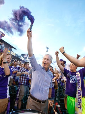 Louisville's Mayor Greg Fischer gets the crowd going with a smoke grenade after Louisville City FC scored their first goal against Charleston.