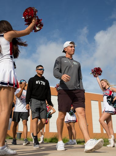Cheerleaders help send off the Veterans Memorial High School baseball team to Round Rock for the state baseball tournament on Wednesday June, 6, 2018.