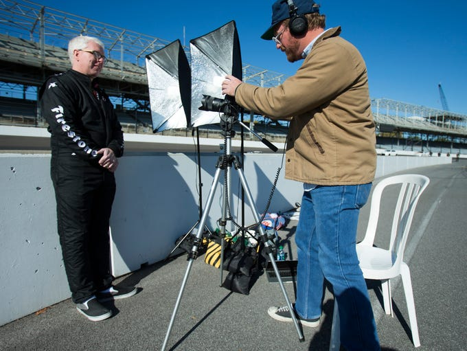 Rob Sanders (left), Indianapolis, is interviewed for