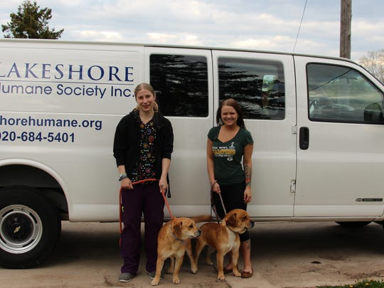 Lakeshore Humane Society staff and LHS dogs stand in front of the society's newly restored van, complete with new logo. Van restoration was completed by Lakeshore Technical College students with donated parts from Brown's of Two Rivers.