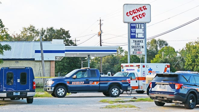 """Crime scene tape and law enforcement vehicles surrounded the Corner Stop convenience store in Blackville on Tuesday morning, Sept. 8, after the store's owner, """"Andy"""" Patel, was shot and killed."""