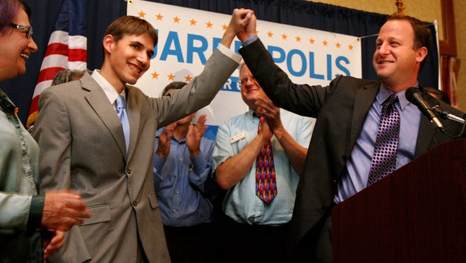 Marlon Reis, left, with Rep. Jared Polis, D-Colo., on Aug. 12, 2008, in Broomfield.
