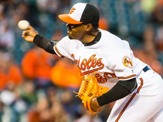 Orioles relief pitcher Mychal Givens (60) throws to the plate against Minnesota at Oriole Park at Camden Yards on Monday, April 4 in Baltimore.
