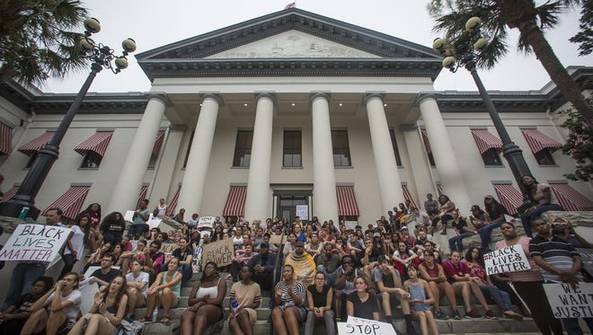 Protesters took to the Old Florida State Capitol to voice their frustrations with gun violence in a rally coordinated by the Students for a Democratic Society organization.