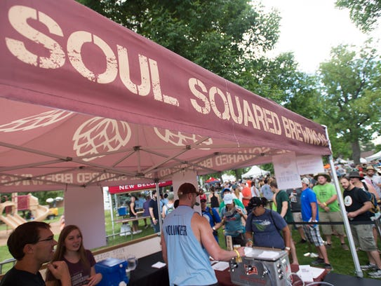 People line up to try beer samples from Soul Squared