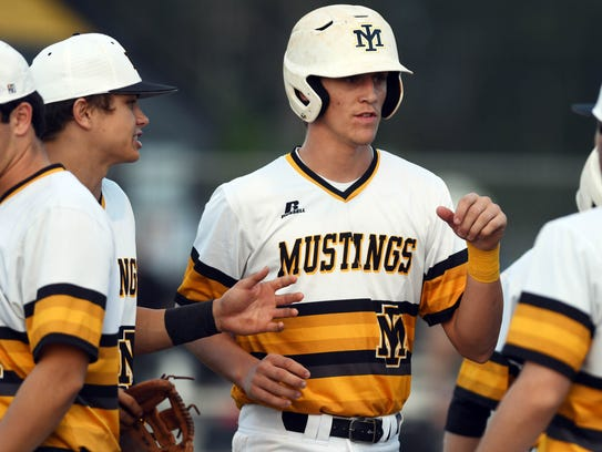 Mason Denaburg of Merritt Island gets high fives from