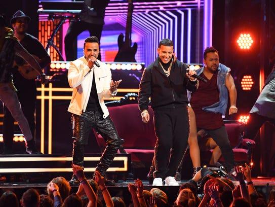 Luis Fonsi and Daddy Yankee featuring Zuleyka Rivera
